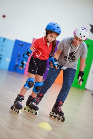Photo of Dubai Skate Academy coach teaching student